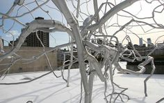 Roxy Paine sculpture installed on a roof garden in New York