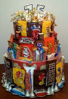 I had a blast making this 3 tiered candy and popcorn cake for my hard to buy for but chocolate loving father-in-law's birthday! 3 stacked, round cardboard boxes, a boatload of candy and a glue gun! (birthday cake for teens) Candy Birthday Cakes, Candy Cakes, Cupcake Cakes, Cupcakes, 75th Birthday, Adult Birthday Party, Diy Birthday, Birthday Ideas, Over The Hill Gifts