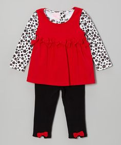 There's nothing like a soft, comfy outfit to inspire smiles and giggles. This sweet set includes a pretty tunic full of embellishments, plus a long-sleeve undershirt and a pair of leggings with a stretchy elastic waistband.Includes tunic, top and leggings100% polyesterMachine wash; tumble dry