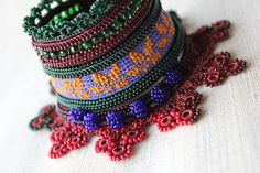 crochet cuff bracelet with yellow and purple embroidered base