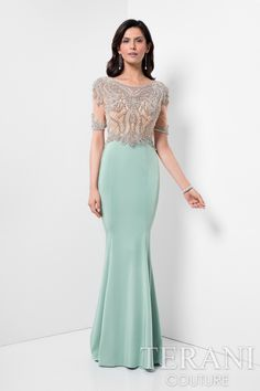 Mother of the bride dress featuring brillant artwork of crystals and beads that illuminate a bodice over a multi panel fit + flare crepe skirt. This wedding day dress is the perfect outfit for the big day and it comes in mint nude, navy and blush.