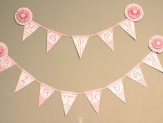 I like this banner and think I could make my own with pink string and cute pink cardstock paper
