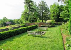 Oatlands Historic House & Gardens- lower terrace; comfortable benches; brick wall; boxwoods; distant barn; great picnic spot! Pinned from Big Old Houses.