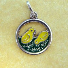 This is the cutest little German charm with two enameled Easter chicks