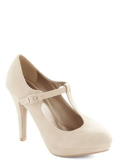 Fashion Show Must Go On Heel in Beige. Exciting wardrobe changes and pre-show lineup adjustments are a stylish cinch when carried out in these beige T-strap heels! #cream #wedding #modcloth