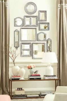 A beautiful gallery of mirrors over a sideboard