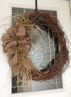 Rustic burlap wreath.... Want to make one for our front door with some fall flowers added to it.