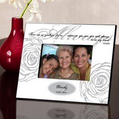 Featuring an impactful quote by Ghandi, this personalized 'Always' memorial picture frame provides families with an attractive and appropriate way to display the smile of a loved one who has passed on. The frame are available in three colors, each featuring an elegant rose-shaped accents and script font. This memorial frame can be ordered at http://myweddingreceptionideas.com/personalized_always_memorial_picture_frame.asp