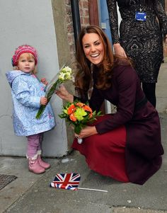 In Stockton-On-Tees, 2-year-old Lola Mackay would not let go of the flowers she was supposed to present to the Duchess of Cambridge. #KateMiddleton (Photo by: Paul Ellis/Getty Images)