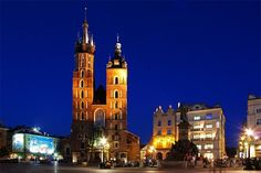 Rynkek Glowny, Krakow, Poland * At the heart of Krakow's Old Town, Rynek Glowny--the Main Market Square--is dominated by the mismatched towers of St. Mary's Church and the vaulted arcades of the 15th century Cloth Hall. Rynek Glowny is Europe's largest medievel market square, and is the focus for many of Krakow's festivals and outdoor events.
