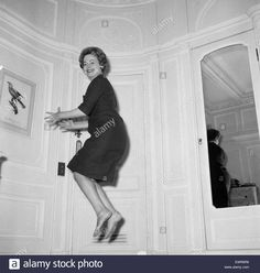 olivia-de-havilland-playing-a-jumping-game-with-her-husband-20th-november-EWR6R6.jpg 1,300×1,371 pixels
