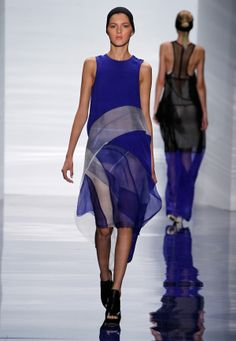 Look 18:  Cobalt silk crepe sleeveless high-low top with bi-color white sash. Cobalt silk gauze circular seam dress with swoosh of white.  White silk gauze circular seam skirt with cobalt swoosh.