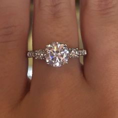 with or without diamond band and maybe smaller central diamond