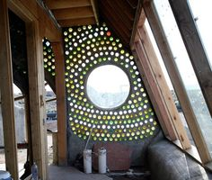 """Really cool """"cordwood"""" wall made with glass bottles. Love it!"""