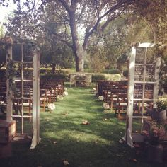 Rustic shabby chic wedding. If we use those shutters... we can use them as aisle markers