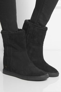 Concealed wedge heel measures approximately 25mm/ 1 inch Black suede and shearling Pull on