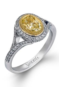 Brides.com: 30 Shimmering Yellow Diamond Engagement Rings Style 100-903, 18K white and yellow gold engagement ring with a 1.51ct yellow diamond center and 1.02ct of round diamonds along the halo, $23,460, Croghan's Jewel BoxPhoto: Courtesy of A.Jaffe