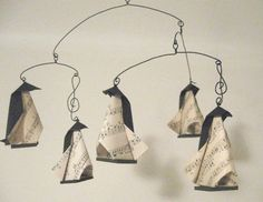 Musical Origami Penguin Mobile (5 penguins and wire clefs). $49.00, via Etsy.