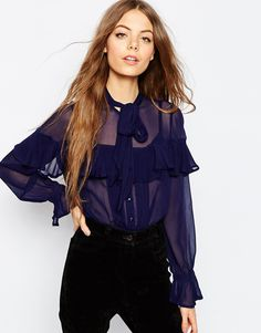 Does exactly what it says on the tin... The ULTIMATE pussy bow blouse.