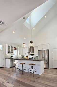 Love the grey tint on the wood floors with the stainless appliances