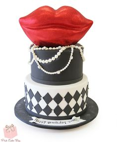 Jule's birthday cake - the lips are fashioned after Marilyn Monroe.  The cake also includes rubies, diamonds and pearl necklaces