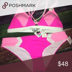 Medium Victoria Secret swim suit combo Medium top and medium pink swim suit combo. This one won't last long!! Brand new with tags - Victoria Secret. Pay less than retail!! Victoria's Secret Swim Bikinis