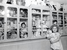 Shirley Temple & her doll collection.  The Mickey Mouse in the rear on the top shelf was given to her by Walt Disney.