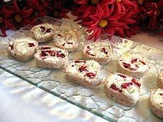 Simple & Delicious Cranberry Cream Cheese Pinwheels.  For Christmas use the green spinach tortillas.  Very tasty and pretty.