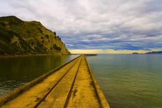 Tokomaru bay, there was a time when up to 6000 people were employed here in the meat freezing and export works South Island, What Is Like, Kiwi, Railroad Tracks, New Zealand, Cloud, Identity, Ipad, Heaven