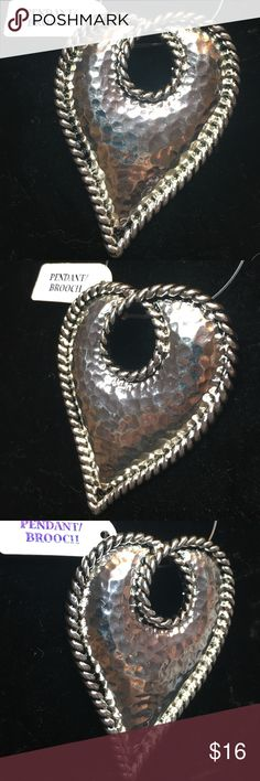 "Hammered Heart pendant silver tone Hammered Heart pendant silver tone.   Never been worn.   Approximately 3"" tall x 2"" wide.  Rope look edging the Heart. Jewelry Necklaces"