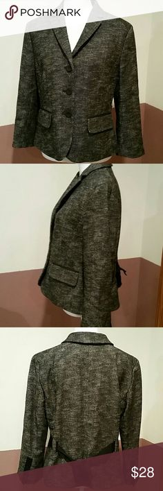 Ann Taylor Wool Tweed Coat 55% wool, 45% cotton and fully lined. Black accents on outside of sleeves that match the fabric of the buttons and tie on the back that skirts out the bottom. Accents also on front pockets which are fake. Breastline across laying flat measures 20, arm inseam 13.75 and length shoulder to bottom of coat 22.5 inches. Backside shoulder to shoulder seam 16.25 inches. Great condition, no flaws. Timeless. Ann Taylor Jackets & Coats Blazers