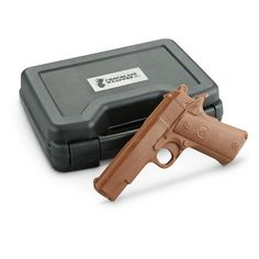 Chocolate Pistol! Almost a full pound of rich, scrumptious milk chocolate with realistic pistol detailing. Packaged in a real, padded gun case for ultimate authenticity. A great gift for any shooting or gun enthusiast.