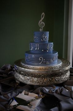 """Made me think...Maybe we can incorporate our rings into the design of the cake...the piping could be celtic knots and """"Once upon a dream"""" music!? musical themed wedding cake"""