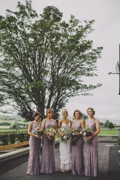 Elegant long lavender bridesmaid dresses | Image by Ten21 Photography