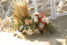 Beach clamshell flowers by Flower Duet.