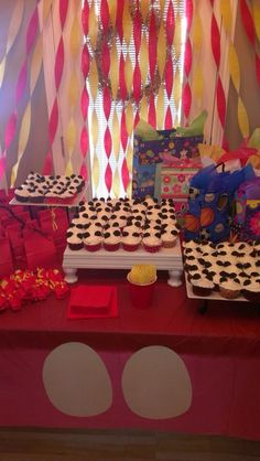 Mickey & Minnie Mouse themed party. Mouse ears cupcakes, goodie bags and decor.