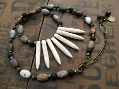 Tribal Necklace, white spike necklace, rustic necklace with white howlite spikes, jasper, agate, basalt, iron pyrite, and antiqued brass. $42.00, via Etsy.