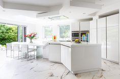 Bi-folding doors create a seamless link between inside and out Kitchen Pantry, Kitchen Island, Corian, Folding Doors, Ideal Home, Kitchen Design, Slg, Bespoke, Lotus