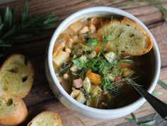 Ribollita: a famous Tuscan soup made with vegetables, fresh herbs and bread. This rustic soup is gently simmered so the flavors meld together beautifully.