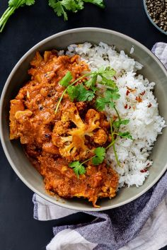 Cauliflower tikka masala is the perfect easy vegetarian dinner served with steamed rice. It's also a great recipe for feeding a crowd. #glutenfreerecipe #cauliflowercurry #tikkamasala #vegetarianrecipe #easydinner #simplydeliciousrecipes #vegetariandinner #glutenfreedinner