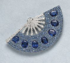 Michele Della Valle, An Impressive Sapphire, Kyanite and Diamond Brooch Designed as a pavé-set sapphire and diamond fan, set with oval-cut sapphires, embellished with seven oval-cut kyanite, mounted in 18K white gold, length 3 inches.