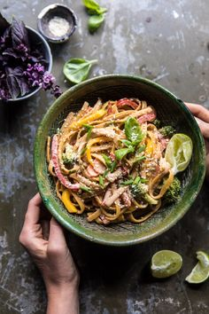 This quick meal is made using a spicy sweet sesame sauce, noodles, lots of veggies, shredded chicken, and fresh basil. It's both healthy AND delicious, and is the perfect dinner for just about any night of the week. Bonus? Leftovers are great for lunch, warm or cold!