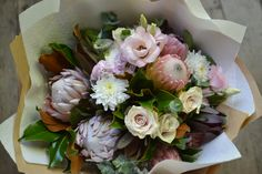 Generous birthday bouquet of king proteas, proteas, roses, lisianthus, leucadendrons.