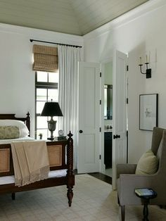 bamboo shades with neutral-curtains-bedroom, visit www.milettedoors.com to see our full line of doors