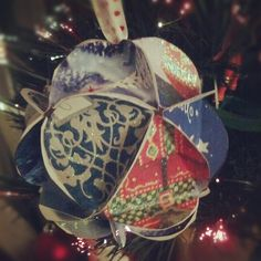 I made this ornament out of recycled holiday cards from the year before. Super cute and a great addition for the Christmas tree every year :)    http://www.christmascards4less.com/pdf/christmas-cards-crafts/card_ball_ornament_template.pdf