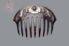 GEORG JENSEN Haircomb in Skonvirke-aesthetic with clear influence of Charles Robert Ashbee, in symmetrical design of naturalistic flowers and leaves with scroll wire work, set with labradorites (Very early Georg Jensen design work of museum quality). Marked G.I./830/S Denmark.