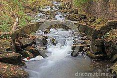 Stone Arch At Limehouse stock photo. Image of mill, hills - 101890748 Fencing, Conservation, Ontario, Waterfall, Arch, Stock Photos, Stone, Outdoor, Black