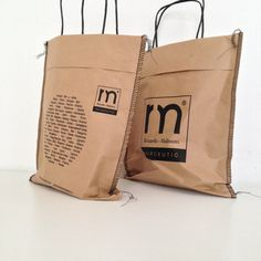 cement bags w/twisted paper handle | packaging specialist - unconventional #packaging solutions