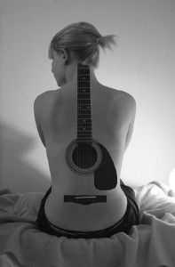 Beautiful guitar tattoo on the whole back. The body is a canvass and this design makes use of the entire back to paint a picture of a life size guitar which goes well with the shape of the body.