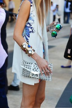 mirrored sunglasses. metallic shoes. metalic accessories. lucite clutches., head-to-toe white.